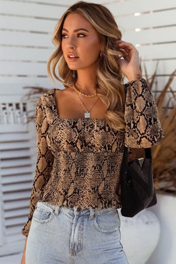 Girl wearing the Moon River Top, layered necklaces, light washed jeans and black shoulder bag.