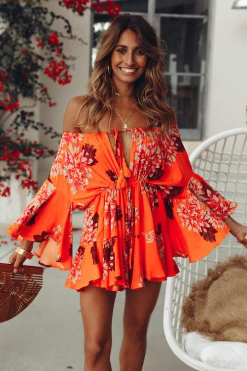 Girl wearing the Carlyn Orange Floral Romper.