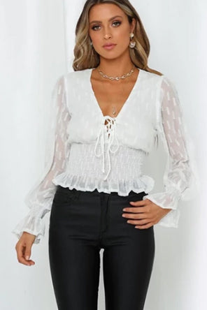 Girl wearing the Tatum Ruched White Top, black trousers and boho jewelries.