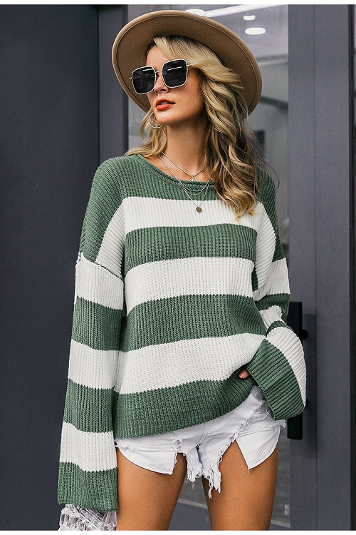 Girl wearing green and white stripes Elisha Oversized Striped Sweater, boho brown hat, sunglasses and raw hem white shorts.