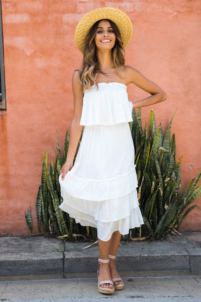 Girl wearing the white Jodi Two Piece Set, boho woven hat and nude wedge sandals.