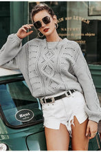 Load image into Gallery viewer, Girl leaning on a green car wearing gray Ice Ice Baby Knit Sweater, square framed sunglasses, black belt and white shorts