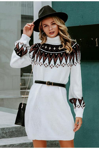 Girl wearing the cosy and bohemian Bea Geometric Sweater Dress, black belt and black hat