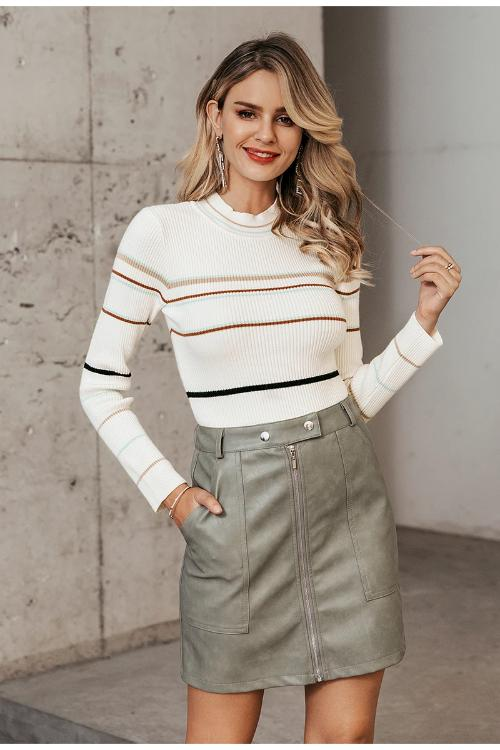 Girl wearing her Reiza Striped Knitted Sweater and gray mini skirt.