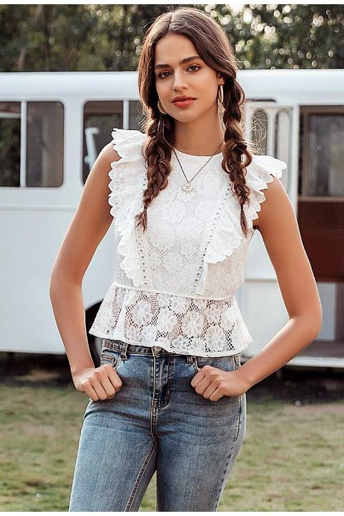 Girl wearing Maica Ruffled Lace Top, jeans, hoop earrings and boho necklace.