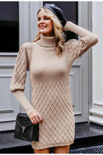 Load image into Gallery viewer, Girl wearing the khaki Clariz Cable Knit Sweater Dress, black shoulder bag, black beret hat and dangling earrings.