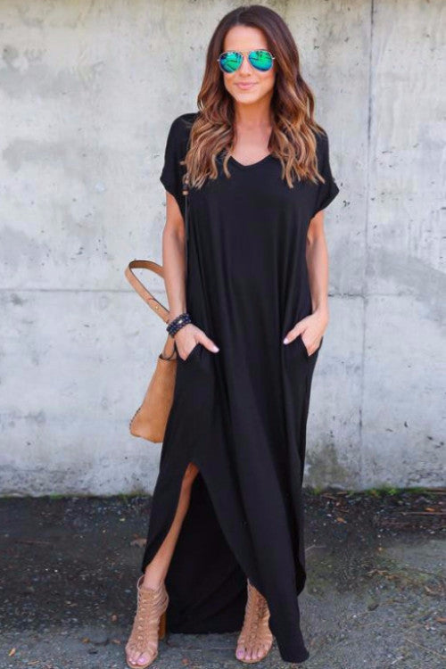 Girl wearing the black Analeah Maxi Shirt Dress, mirrored blue lens sunglasses, brown bag and brown sandals.