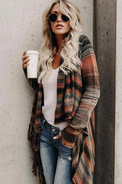 Girl holding a white cup and wearing the Adrianna Striped Fringe Shawl, sunglasses, jeans and white top.