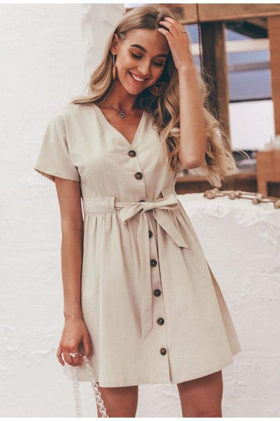 Girl wearing the Dolly Bow Linen Dress and boho jewelries.