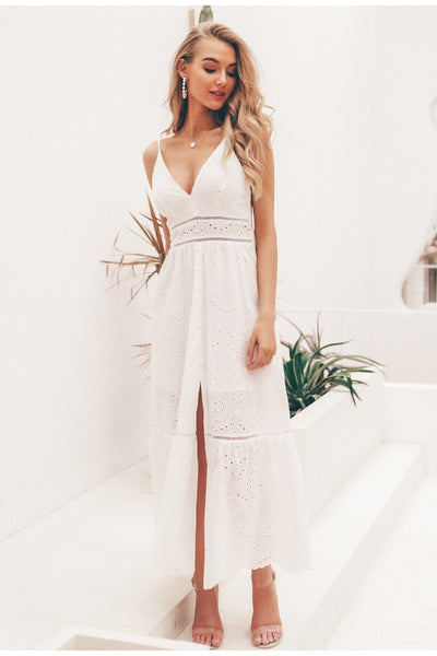 Girl wearing the Mira Eyelet Maxi Dress, clear strap sandals and jewelries.