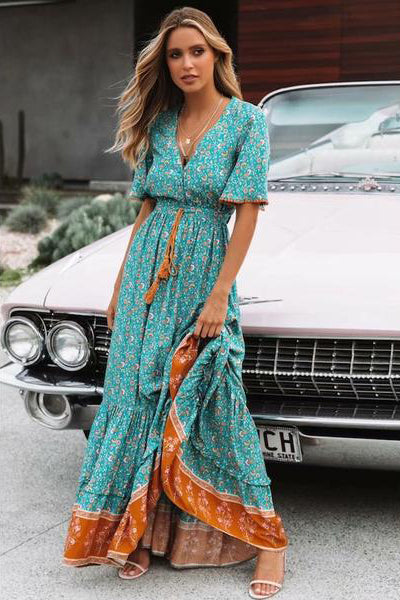 Girl standing in front of a car wearing the Katrin Boho Maxi Dress.