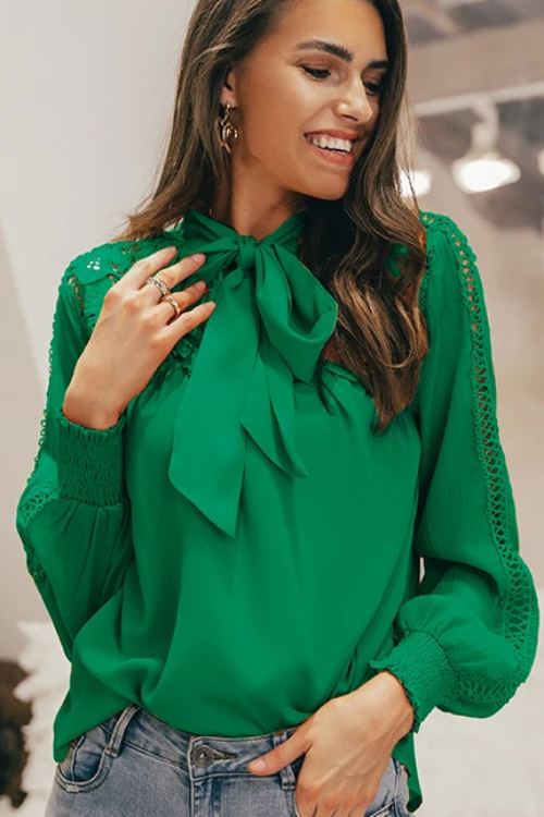 Girl wearing the green Letecia Meshed Ruffled Dress, dainty gold jewelries, and denim trousers.