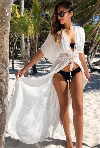 Girl wearing the Vanessa Beach Cover Up, black two piece swimsuit and black sunglasses.