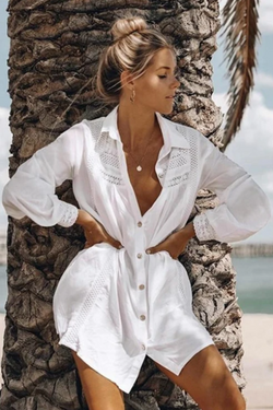 Girl leaning on a tree wearing the Vernice Shirt Beach Cover Up.
