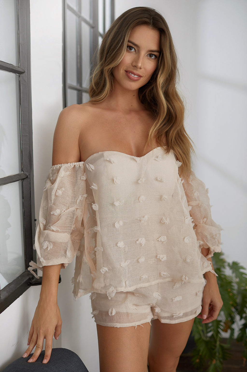 Kiss and tell off shoulder romper