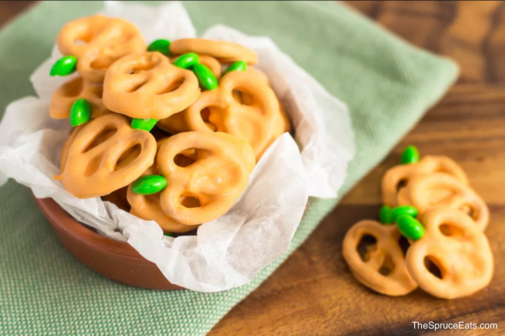 Delicious candy coated pretzels made to look like pumpkins for Halloween treats
