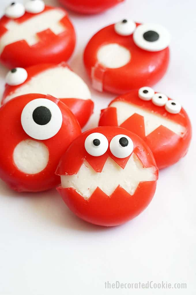 Babybel cheese snacks carved to look like super cute little monsters to add a savory snack to Halloween party snack spread