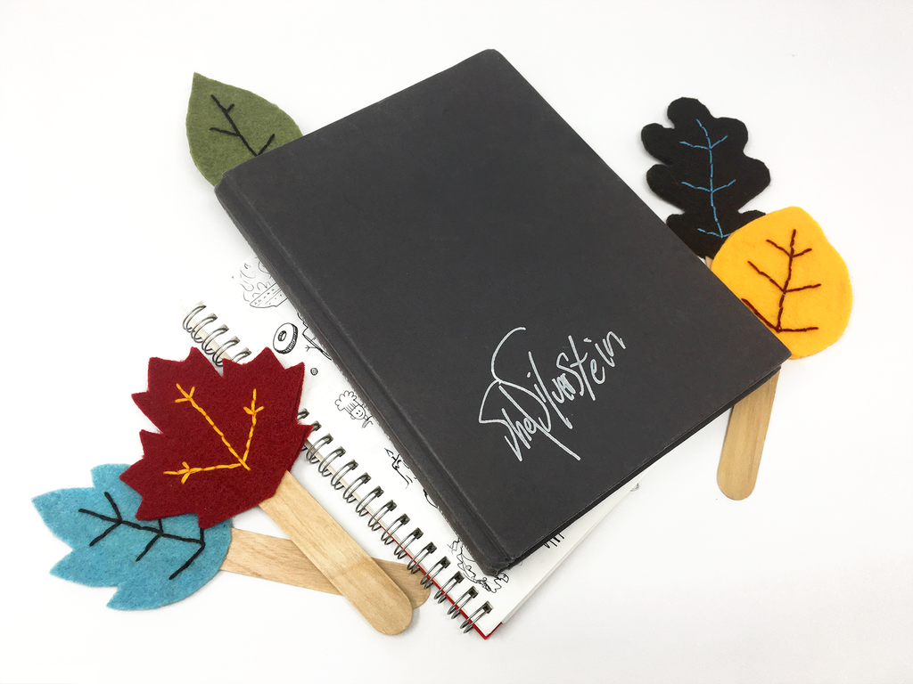 Fall-themed leaf bookmark gifts made using felt, thread, and jumbo possible sticks