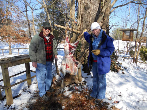 Dad and I skinning a deer in the dead of winter. It was pretty much frozen!
