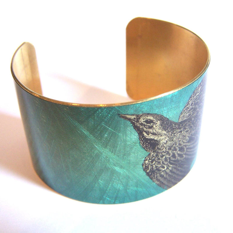Blue brass cuff with bird design