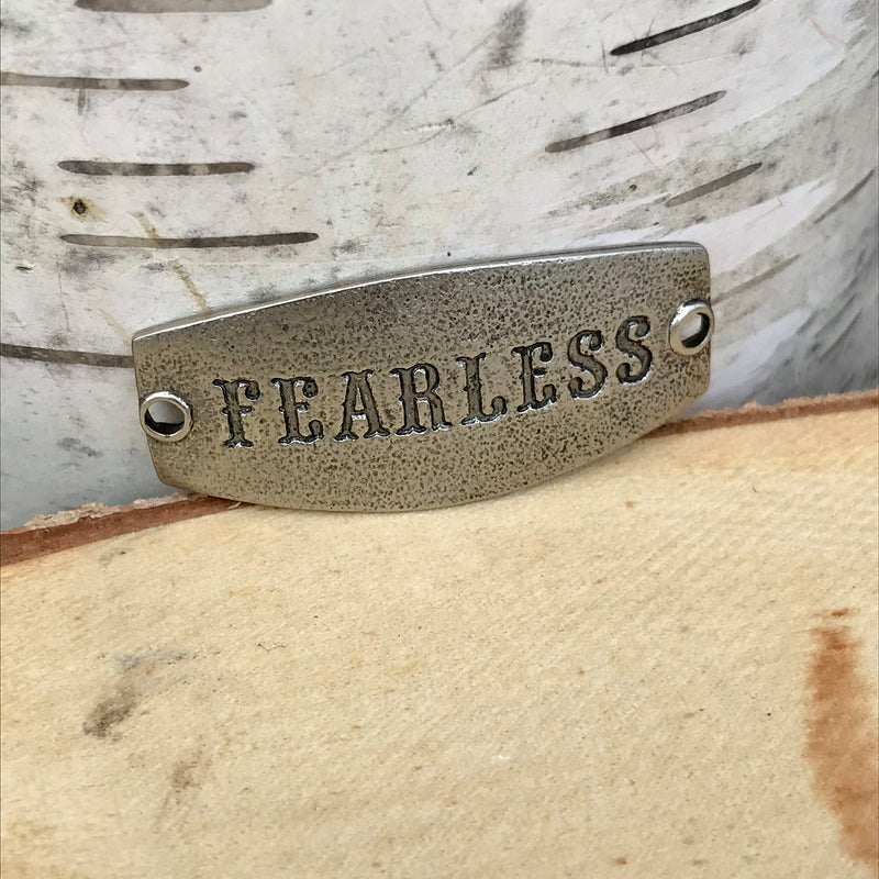 antique silver Lenny & Eva sentiment stamped with FEARLESS