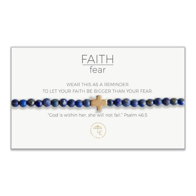 "Blue lapiz lazuli beaded stretch bracelet with gold cross. Card states, ""Wear this as a reminder to let your faith be bigger than your fear."" and ""God is within her, she will not fail."" Psalm 46:5"