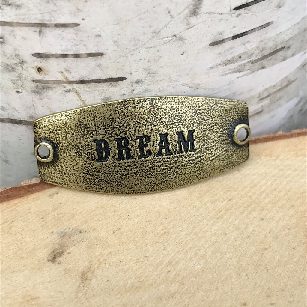 antique brass Lenny & Eva sentiment stamped with DREAM