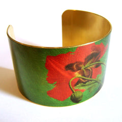 Bright green brass cuff with red poppy design