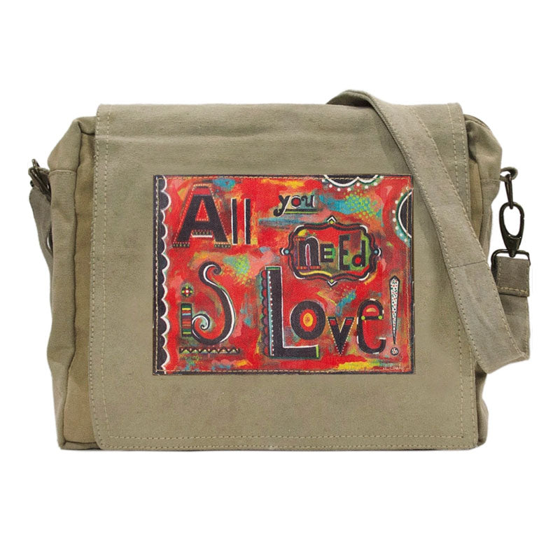 "Tan or olive (colors vary) crossbody bag made of recycled military tents. This bag features a large colorful patch on the flap that reads ""All you need is Love!"" Patch has a red background with patterns in blues, greens, yellows, black and white."