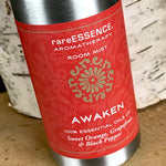 Awaken room mist in metal spray bottle with orange label.