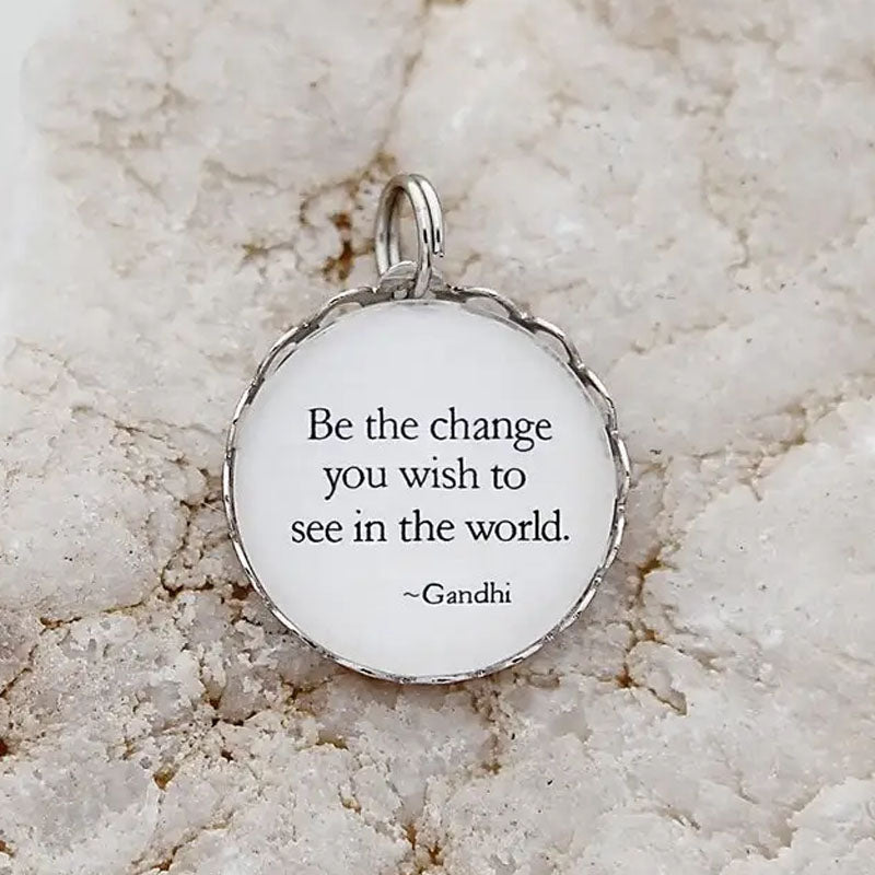 "Necklace pendant that says, ""Be the change you wish to see in the world. ~Gandhi"""