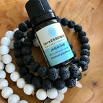 Stack of Lava Rock Essential Oil Aromatherapy Diffuser Bracelets by Lotus Jewelry Studio. Pictured with Jasmine Essential Oil by rareESSENCE.