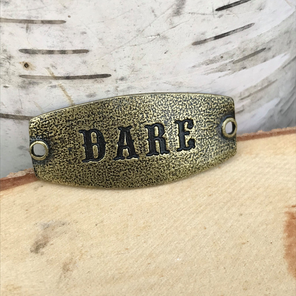 antique brass Lenny & Eva sentiment stamped with DARE