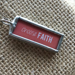 "Soldered necklace pendant with the words ""choose faith"""