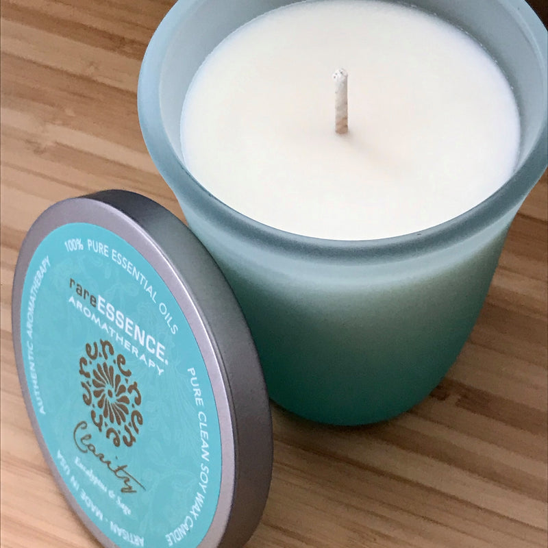 Clarity soy candle in blue frosted glass jar.