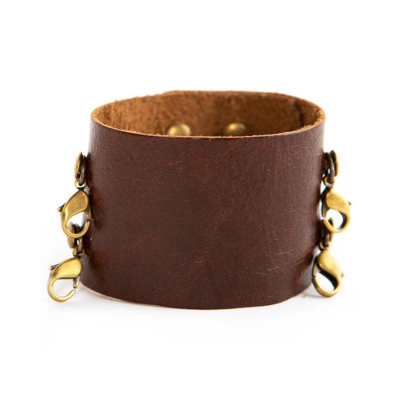 Dark chestnut wide leather cuff with brass clasps from Lenny & Eva jewelry