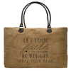 """Let your faith be bigger than your fear"" is stamped on this large market tote made from recycled military tents."