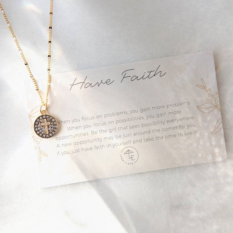 "Gold have faith necklace on top of a card that reads, ""When you focus on problems, you gain more problems. When you focus on possibilities, you gain more opportunities. Be the girl that sees possibility everywhere. A new opportunity may be just around the corner for you if you just have faith in yourself and take the time to see it."""