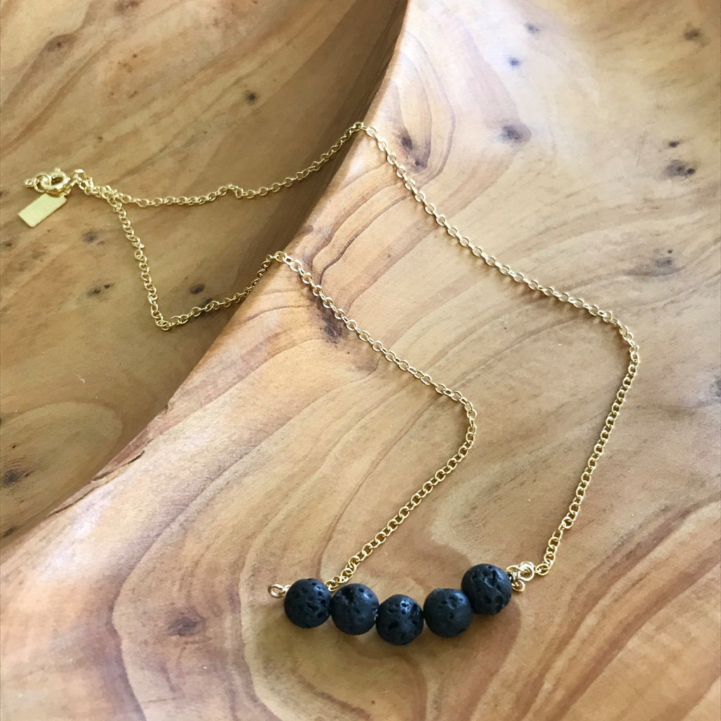 Gold filled necklace with black lava rocks for essential oil aromatherapy. Made in the U.S.A. by Lotus Jewelry Studio.