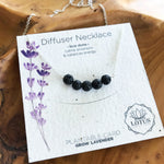 A sterling silver necklace with a bar of black lava rocks to use for essential oil aromatherapy. Made in the U.S.A. by Lotus Jewelry Studio.