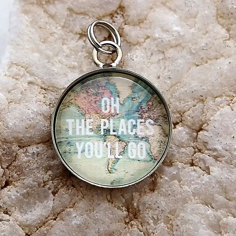 "Circle pendant with a map background and text that reads ""Oh the places you'll go"""