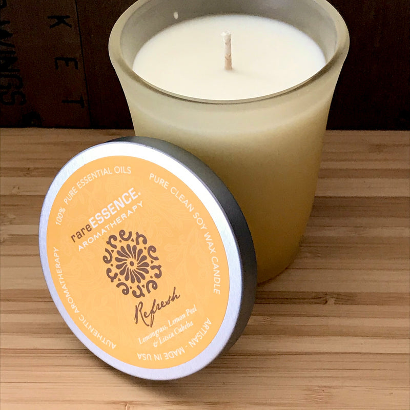 Refresh soy candle in a yellow frosted glass jar.