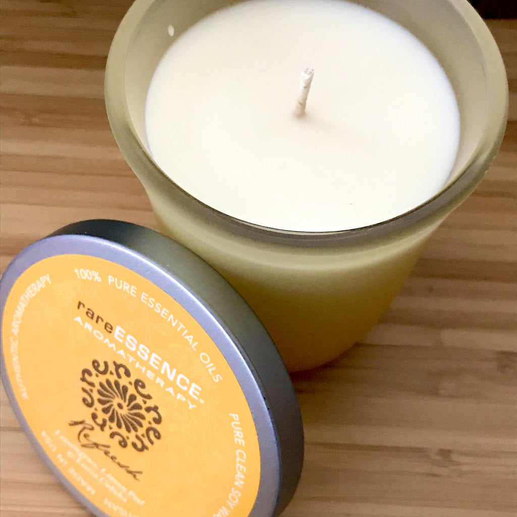 Refresh soy candle made from lemongrass, lemon, and litsea cubeba pure essential oils in a yelllow frosted glass jar.
