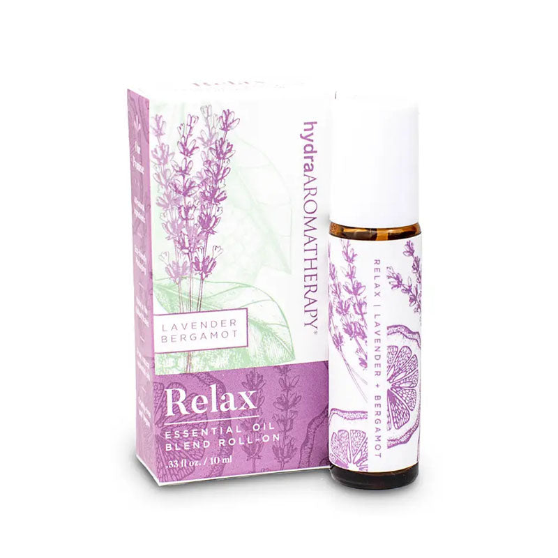 The Relax roll on is a blend of lavender and bergamot essential oils. The bottle is decorated with a purple bergamot fruit and lavender plant design.