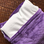 Spa wrap has a purple removable cover with a white muslin pack inside.