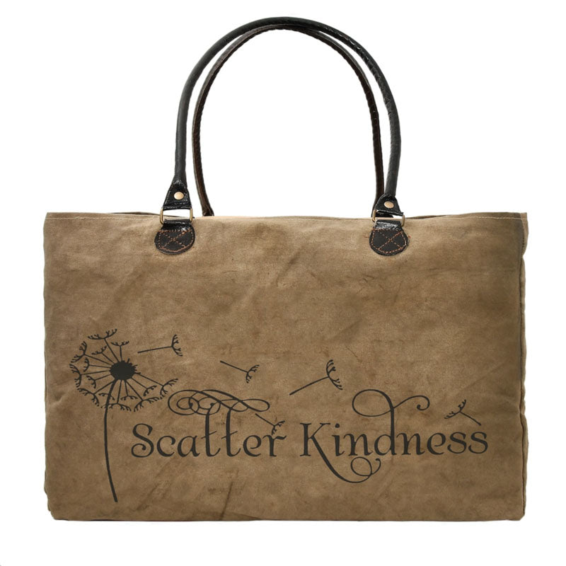 """scatter kindness"" and a dandelion is stamped on this large market tote made from recycled military tents."