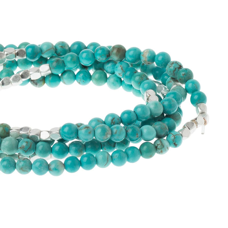 Gorgeous turquoise and silver beads make up this wrap that can be used as either a necklace or a wrap bracelet