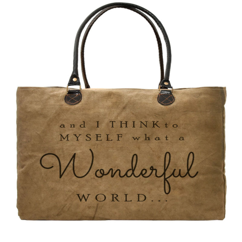 """and I think to myself what a wonderful world..."" is stamped on this large market tote made from recycled military tents."