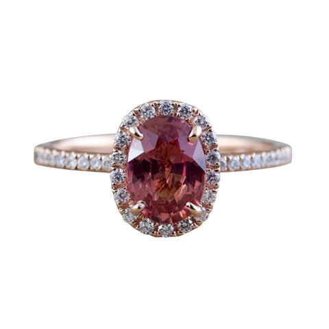Oval peach sapphire and diamond ring