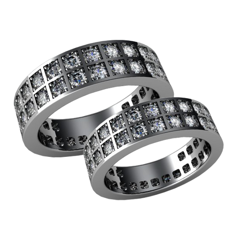 A pair of wedding bands with diamonds